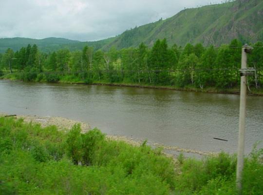A river runs alongside the Trans-Siberian railway
