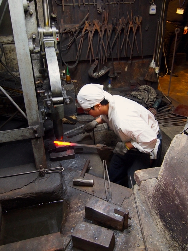 Forging a knife blade at the Mizuno metal studio in Sakai City