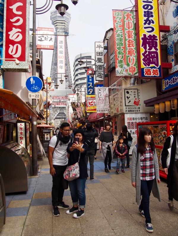 Osaka crowds near Tsutenkaku Tower in Japan