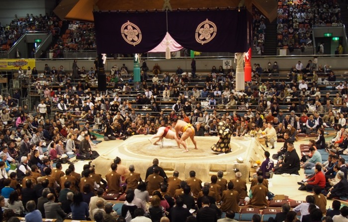 Action at the Osaka grand sumo tournament in the afternoon