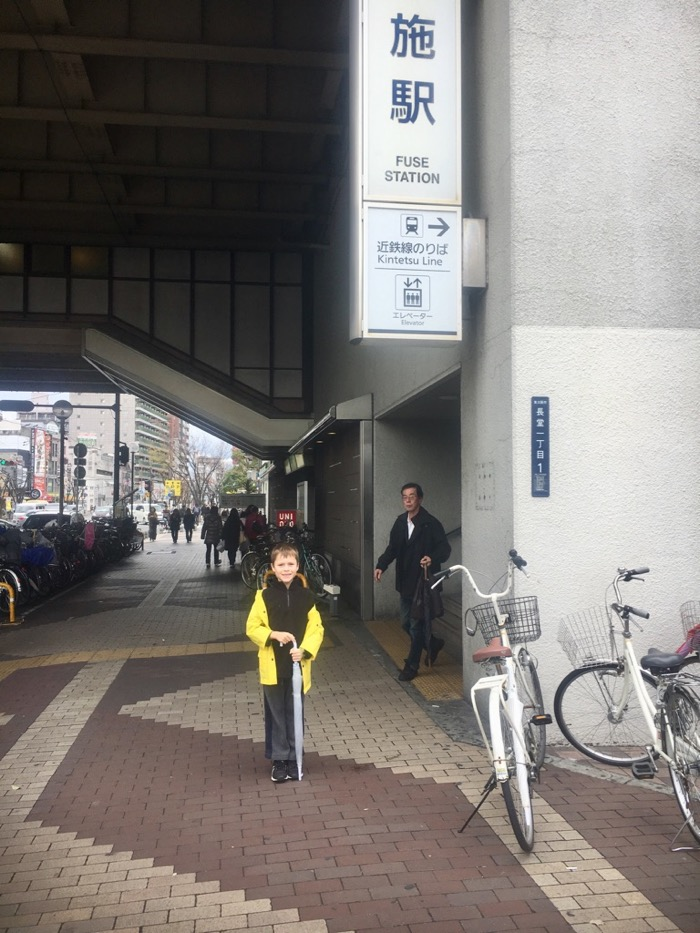 My son outside Fuse train station in Higashi-Osaka